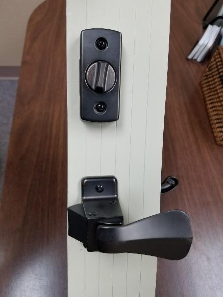 Hardware for storm doors