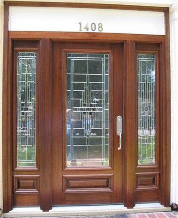 Wood and glass entry door with sidelights in Stafford